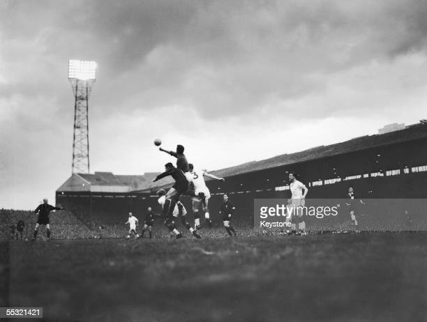Manchester United keeper Harry Gregg punches a ball clear after an attack on goal during a match against AC Milan in the first leg of the European...