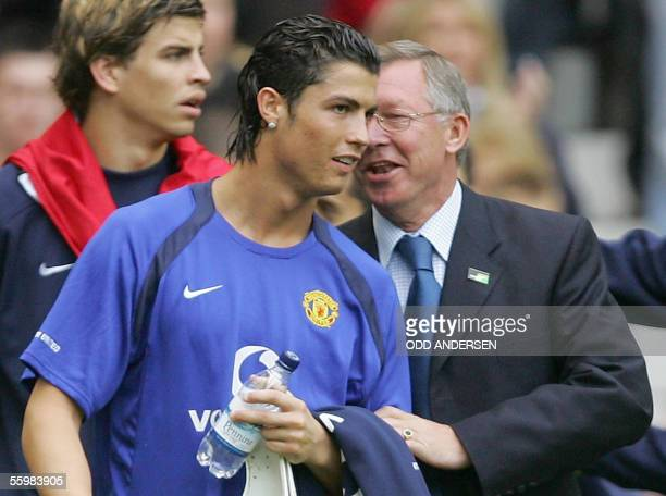 Cristiano Ronaldo of Manchester United speaks with manager Sir Alex Ferguson before playing Tottenham in a premiership match at Old Trafford in...
