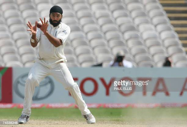 England bowler Monty Panesar catches the ball from West Indies' Darren Sammy at Old Trafford in Manchester northwest England 11 June 2007 Ramdin was...
