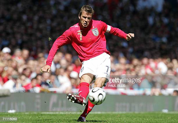 England captain David Beckham crosses the ball during an international friendly soccer match against Jamaica at Old Trafford in Manchester 03 June...