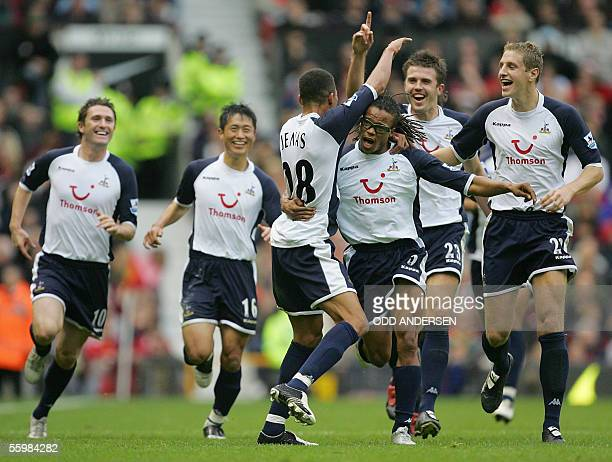Jermaine Jenas of Tottenham celebrates with team mates YoungPyo Lee Robbie Keane Edgar Davids Michael Carrick and Maichael Dawson scoring against...