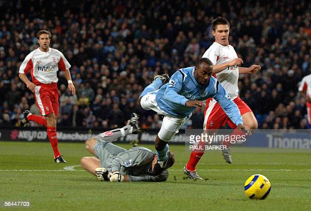 Manchester City's Darius Vassell is brought down by Birmingham goal keeper Nico Vaesen to give a away a penalty during their Premiereship football...