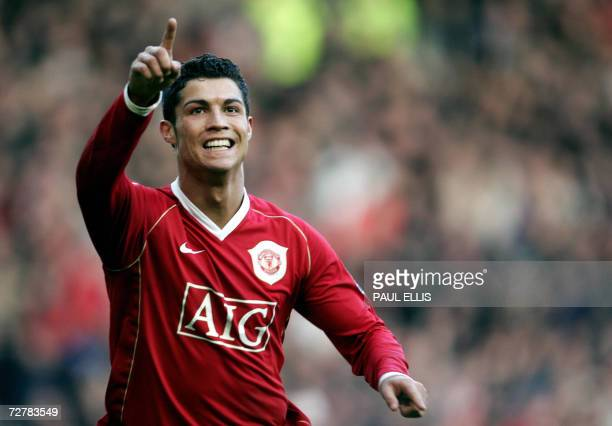 Manchester United's Cristiano Ronaldo celebrates after scoring against Manchester City during their English Premiership football match at Old...