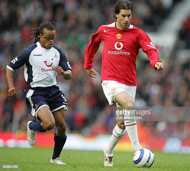 Manchester United's Dutch forward Ruud van Nistelrooy is chased by fellow Dutchman Edgar Davids of Tottenham during a premiership match at Old...