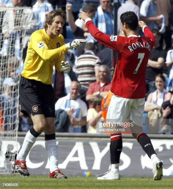 Manchester United's Dutch goalkeeper Edwin Van Der Sar celebrates with teammate Portuguese striker Cristiano Ronaldo at the final whistle after they...