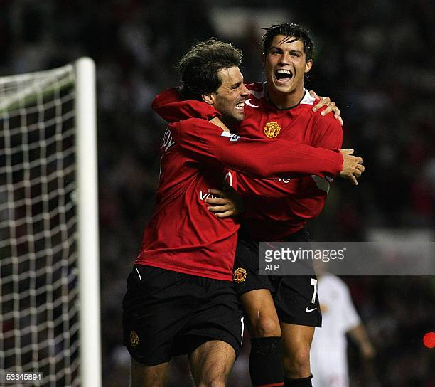 Manchester United's Ruud van Nistelrooy and Cristiano Ronaldo celebrate the 2nd goal against Debreceni in their European Champion's League Qualifier...