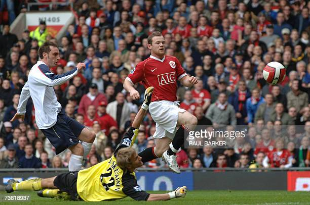 Manchester United's Wayne Rooney chips the ball over Bolton's goal keeper Jussi Jaaskelainen to make it 20 during today's Premiership match at Old...