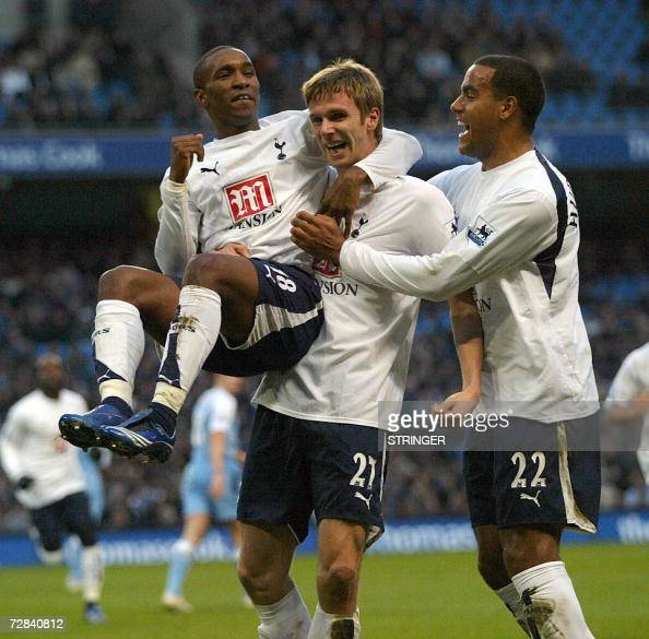 Totenham's Calum Davenport celebrates his first half goal with Jeremain Defoe and Tommy Huddlestone in the Premiership game at The City Of Manchester...