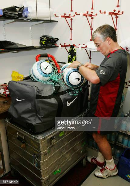 Manchester United kit manager Albert Morgan inspecting the match balls prior to the Barclays Premiership match between Manchester United and Arsenal...