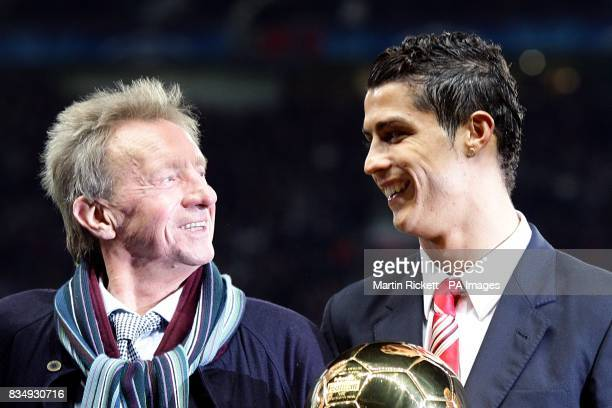 Manchester United legend Denis Law in conversation with newly crowned Ballon d'Or winner Cristiano Ronaldo prior to kickoff