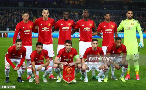 Manchester United line up during the UEFA Europa League quarter final first leg match between RSC Anderlecht and Manchester United at Constant Vanden...