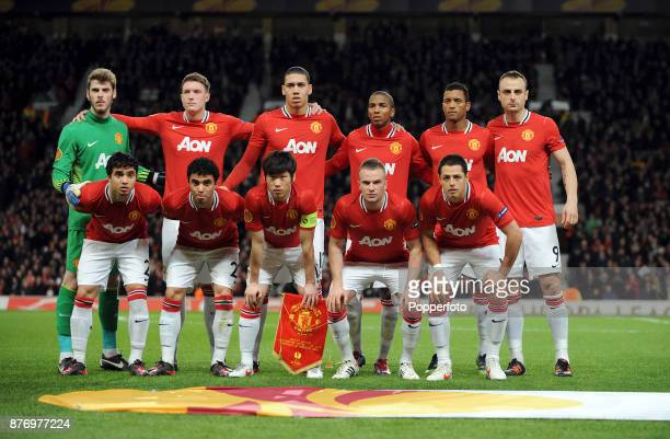 Manchester United line up for a group photo before the Europa League match between Manchester United and Ajax at Old Trafford on February 23 2012 in...