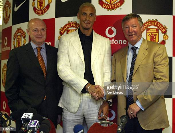 Manchester United manager Alex Ferguson and Chief Executive Peter Kenyon show off new signing Rio Ferdinand at a press conference at Old Trafford...