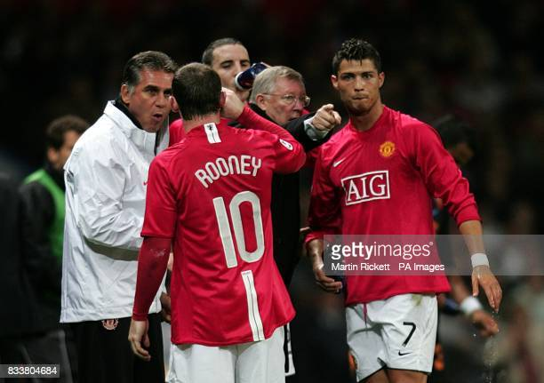 Manchester United manager Alex Ferguson and his assistant Carlos Queiroz give instructions to Wayne Rooney and Cristiano Ronaldo on the touchline