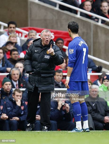 Manchester United manager Alex Ferguson gives instructions to Cristiano Ronaldo on the touchline