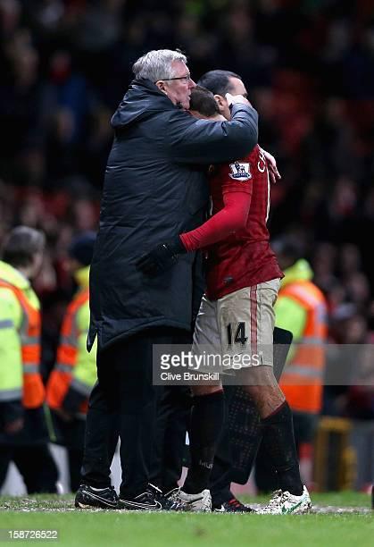 Manchester United manager Alex Ferguson hugs winning goal scorer Javier Hernandez during the Barclays Premier League match between Manchester United...