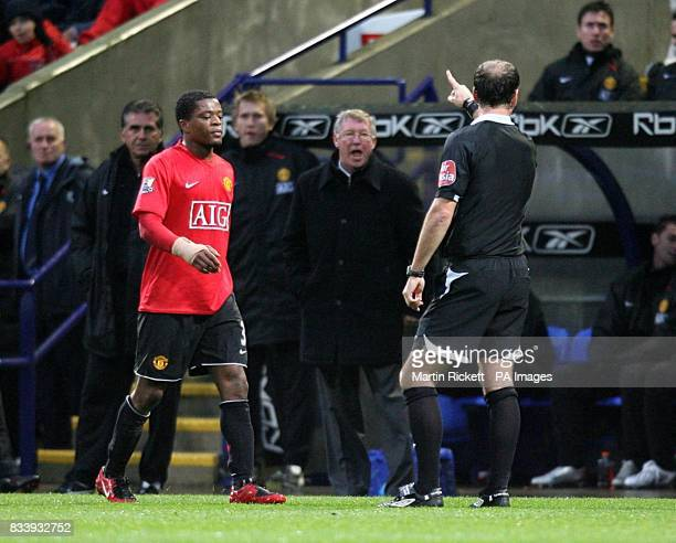 Manchester United manager Alex Ferguson is sent to the stands by referee Mark Clattenburg