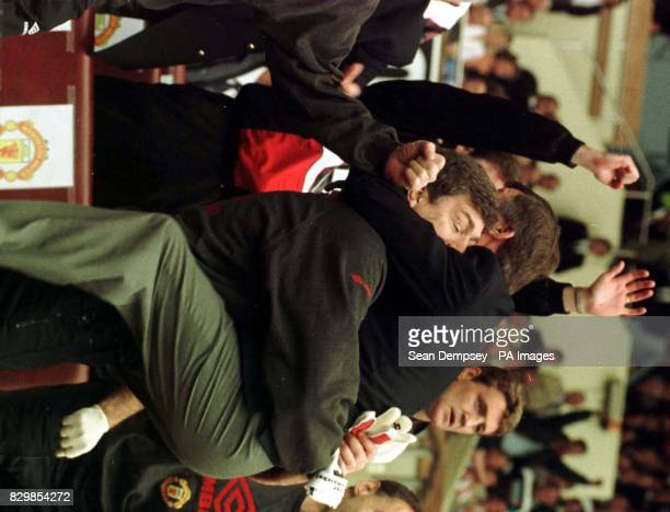 Manchester United manager Alex Ferguson jumps on his assistant Brian Kidd after his side clinched the FA Cup against Liverpool at Wembley