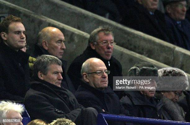 Manchester United manager Alex Ferguson observes the match in the stands after referee Mark Clattenburg dismissed him at half time