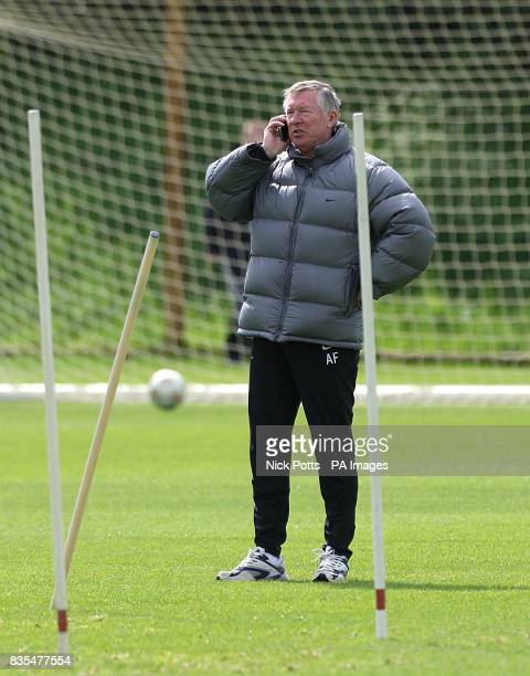 Manchester United manager Alex Ferguson on his mobile phone during the training session