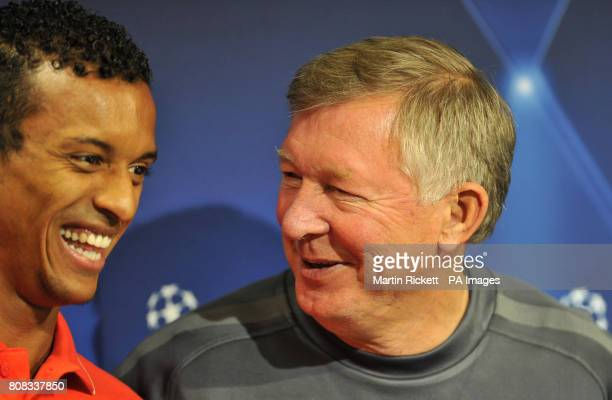 Manchester United manager Alex Ferguson shares a joke with Luis Nani during the press conference at the Estadio Mestalla Valencia Spain