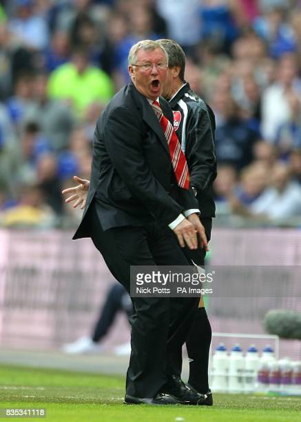 Manchester United manager Alex Ferguson shows his frustration after Danny Welbeck goes down under a tackle by Everton's Phil Jagielka but no penalty...