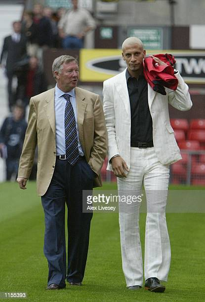 Manchester United manager Alex Ferguson takes a walk with new signing Rio Ferdinind at a press conference at Old Trafford Manchester England on July...