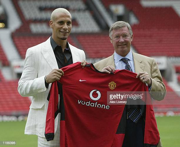 Manchester United manager Alex Ferguson with new signing Rio Ferdinand at a press conference at Old Trafford Manchester England on July 22 2002