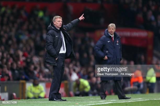 Manchester United manager David Moyes and Arsenal manager Arsene Wenger on the touchline