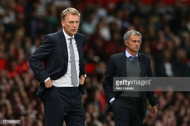 Manchester United Manager David Moyes and Chelsea Manager Jose Mourinho look on during the Barclays Premier League match between Manchester United...