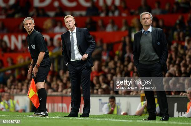 Manchester United manager David Moyes and Chelsea manager Jose Mourinho on the touchline