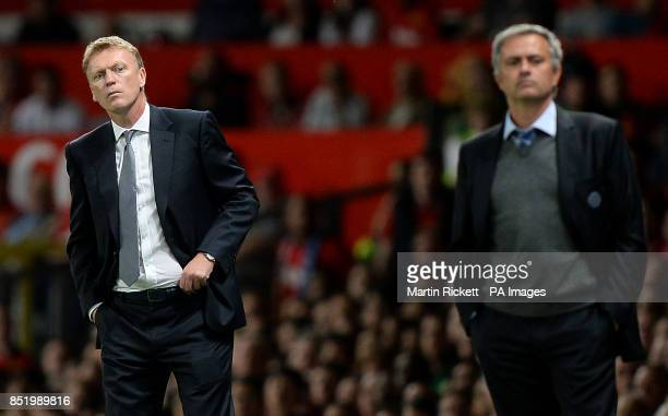 Manchester United manager David Moyes and Chelsea manager Jose Mourinho on the touchline during the Barclays Premier League match at Old Trafford...