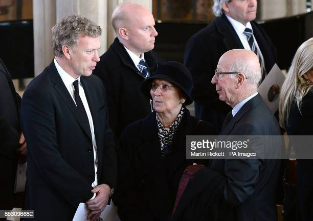 Manchester United manager David Moyes and Sir Bobby Charlton with his wife Norma at the funeral of Tom Finney at St John's Minster Preston