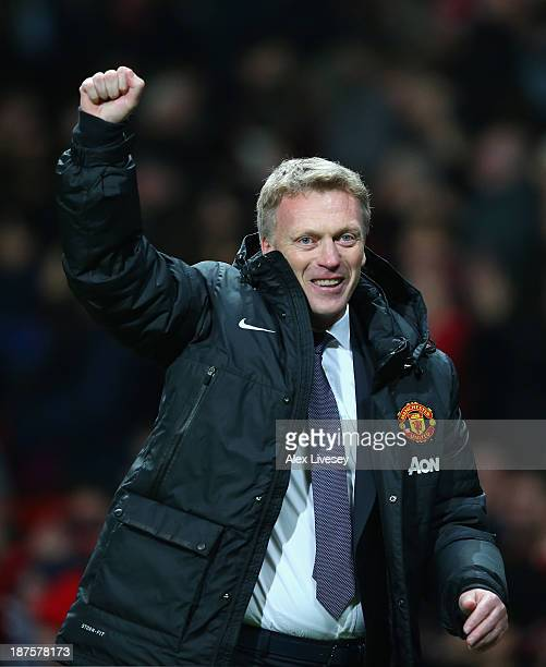 Manchester United Manager David Moyes celebrates at the end of the Barclays Premier League match between Manchester United and Arsenal at Old...