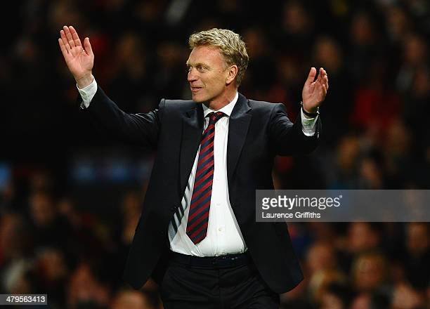 Manchester United Manager David Moyes celebrates at the end of the UEFA Champions League Round of 16 second round match between Manchester United and...