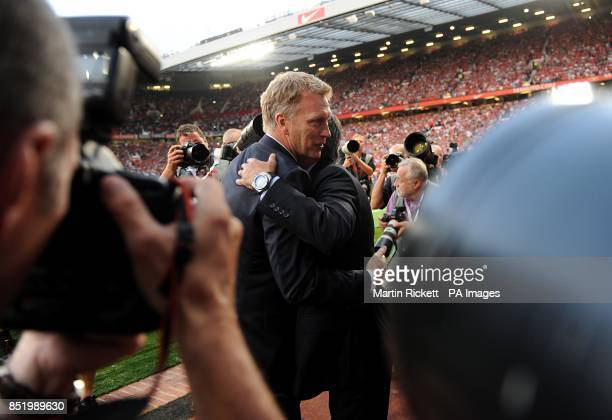 Manchester United manager David Moyes embraces Chelsea manager Jose Mourinho prior to kickoff