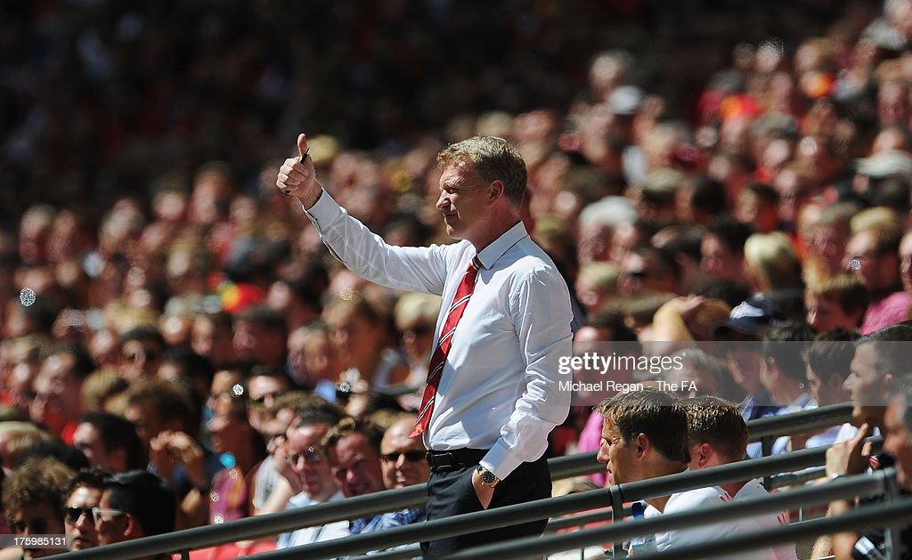 Manchester United manager David Moyes gives the thumbs up during the FA Community Shield match between Manchester United and Wigan Athletic at Wembley Stadium on August 11, 2013 in London, England.