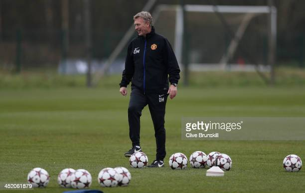 Manchester United manager David Moyes in good spirits during a first team training session ahead of their UEFA Champions League match against Bayer...