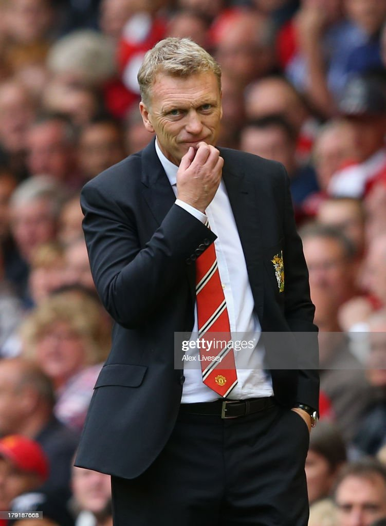 Manchester United Manager <a gi-track='captionPersonalityLinkClicked' href=/galleries/search?phrase=David+Moyes&family=editorial&specificpeople=215482 ng-click='$event.stopPropagation()'>David Moyes</a> looks on during the Barclays Premier League match between Liverpool and Manchester United at Anfield on September 01, 2013 in Liverpool, England.