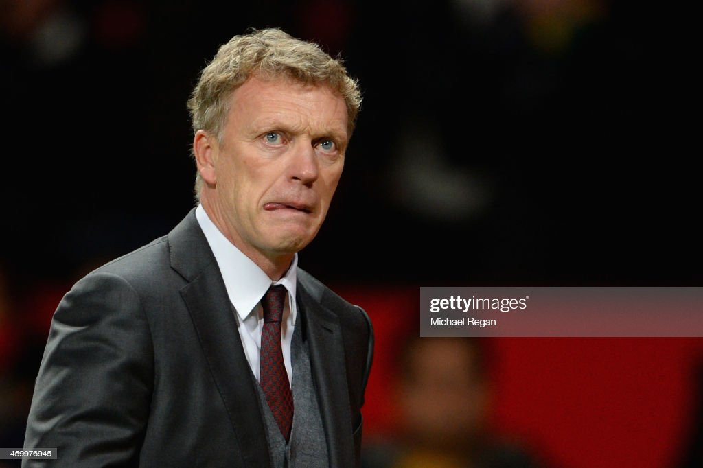 Manchester United Manager <a gi-track='captionPersonalityLinkClicked' href=/galleries/search?phrase=David+Moyes&family=editorial&specificpeople=215482 ng-click='$event.stopPropagation()'>David Moyes</a> reacts at the end of the Barclays Premier League match between Manchester United and Tottenham Hotspur at Old Trafford on January 1, 2014 in Manchester, England.