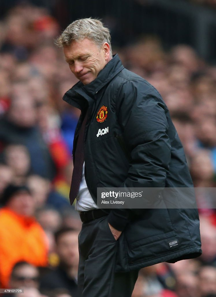Manchester United Manager <a gi-track='captionPersonalityLinkClicked' href=/galleries/search?phrase=David+Moyes&family=editorial&specificpeople=215482 ng-click='$event.stopPropagation()'>David Moyes</a> reacts during the Barclays Premier League match between Manchester United and Liverpool at Old Trafford on March 16, 2014 in Manchester, England.
