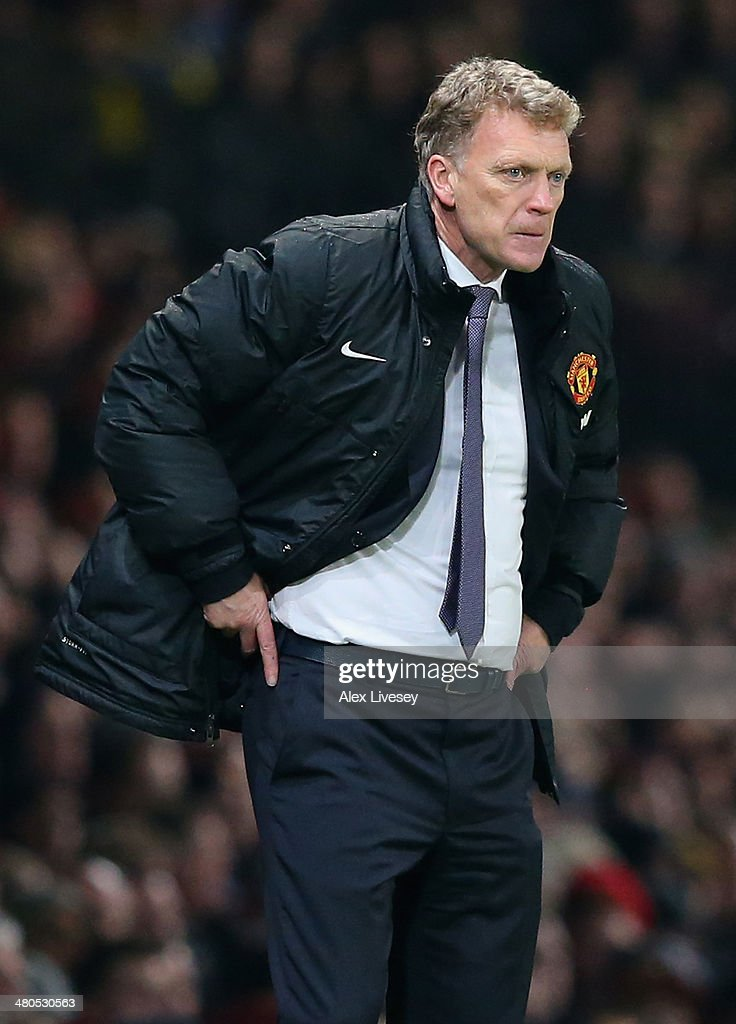 Manchester United Manager David Moyes reacts during the Barclays Premier League match between Manchester United and Manchester City at Old Trafford on March 25, 2014 in Manchester, England.