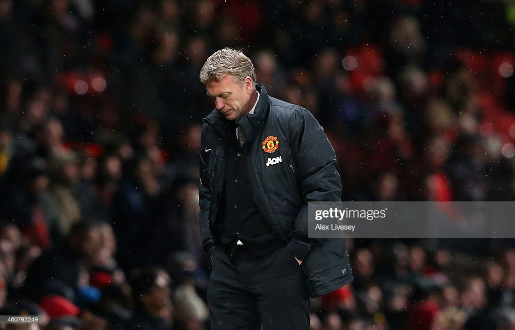 Manchester United Manager <a gi-track='captionPersonalityLinkClicked' href=/galleries/search?phrase=David+Moyes&family=editorial&specificpeople=215482 ng-click='$event.stopPropagation()'>David Moyes</a> reacts during the FA Cup with Budweiser Third round match between Manchester United and Swansea City at Old Trafford on January 5, 2014 in Manchester, England.