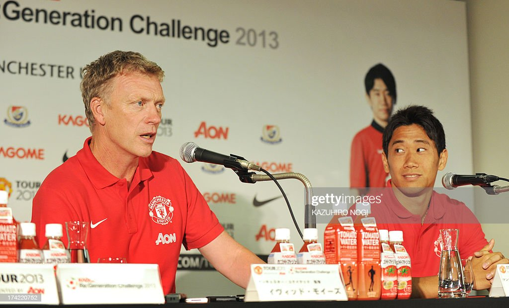 Manchester United manager David Moyes (L) speaks during a press conference prior to a training session at Nissan Stadium in Yokohama, suburban Tokyo on July 22, 2013 while Japanese player Shinji Kagawa (R) looks on. The United will play Yokohama F Marinos on July 23 and then face Kagawa's former J-League club Cerezo Osaka at Nagai Stadium on July 26.