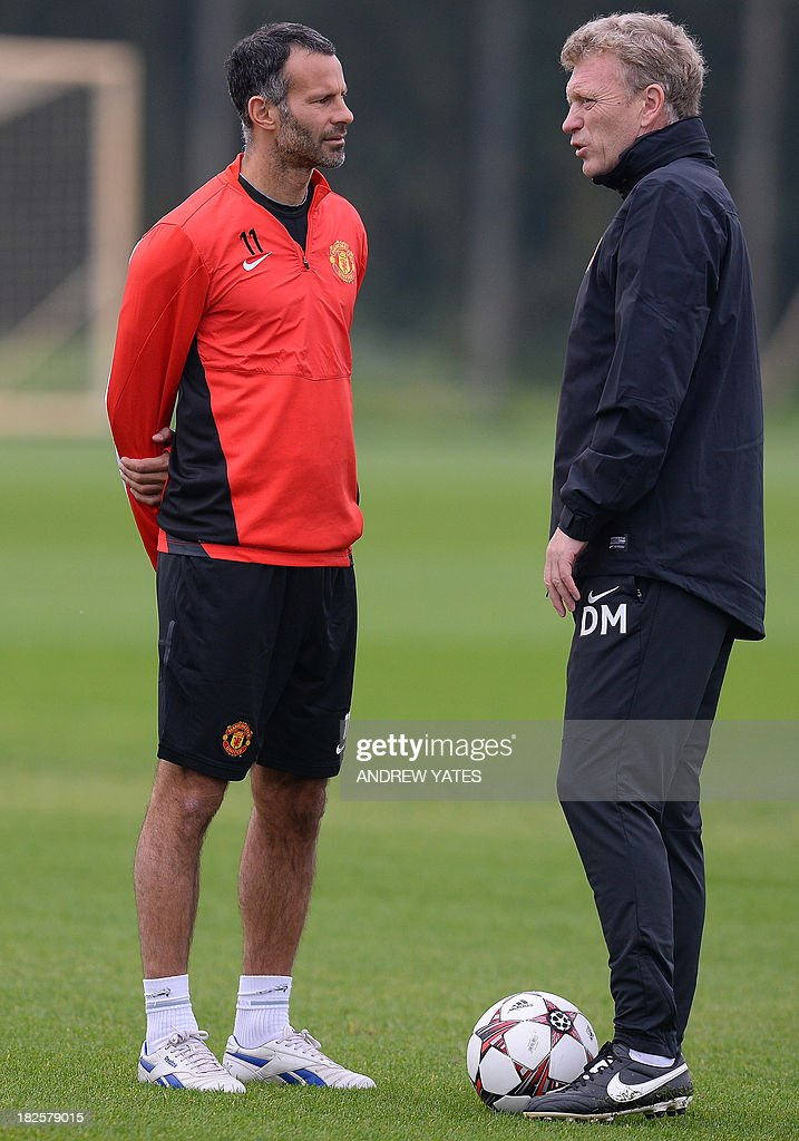 Manchester United manager David Moyes (R) speaks to Manchester United's Welsh midfielder Ryan Giggs during a training session at the team's Carrington training complex in Manchester, north-west England on October 1, 2013, on the eve of their UEFA Champions League group A football match against Shakhtar Donetsk in the Ukraine.
