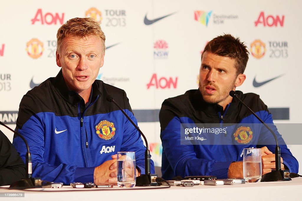 Manchester United manager David Moyes (L) speaks to the media as Michael Carrick (R) looks on during a Manchester United press conference at Museum of Contemporary Art on July 19, 2013 in Sydney, Australia.