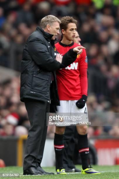 Manchester United manager David Moyes speaks with Adnan Januzaj on the touchline