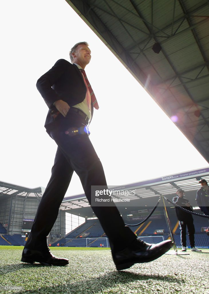 Manchester United manager <a gi-track='captionPersonalityLinkClicked' href=/galleries/search?phrase=David+Moyes&family=editorial&specificpeople=215482 ng-click='$event.stopPropagation()'>David Moyes</a> walks on the pitch before the Barclays Premier League match between Manchester United and West Bromwich Albion at The Hawthorns on March 8, 2014 in West Bromwich, England.
