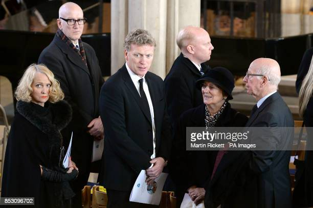 Manchester United manager David Moyes with his wife Pamela and Sir Bobby Charlton with his wife Norma at the funeral of Tom Finney at St John's...
