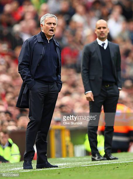 Manchester United manager Jose Mourinho and Manchester City manager Pep Guardiola during the Premier League match between Manchester United and...